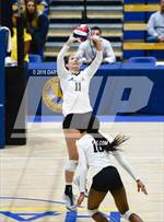 This MaxPreps.com professional photo features Archbishop Mitty high school Makaela Tanaka playing  Volleyball. This photo was shot by Daryl Chan and published on Chan.
