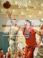 This MaxPreps.com professional photo features Jefferson high school Noah Soto playing  Basketball. This photo was shot by Joe Calomeni and published on Calomeni.