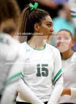 This MaxPreps.com professional photo features Carroll high school Raven Rolle playing  Volleyball. This photo was shot by Gregory LaGrange and published on LaGrange.
