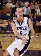 This MaxPreps.com professional photo is from the gallery Cocke County @ Sevier County which features Sevier County high school athletes playing  Basketball.