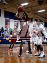 This MaxPreps.com professional photo is from the gallery Chilton County vs Maplesville (Chilton County Tournament) which features Maplesville high school athletes playing  Basketball. This photo was shot by Brandon Sumrall and published on Sumrall.