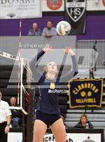 This MaxPreps.com professional photo features Clarkston high school Grace Kraft playing  Volleyball. This photo was shot by Kent Koller and published on Koller.