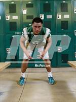 This MaxPreps.com professional photo features De La Salle high school Henry To'oto'o playing  Football. This photo was shot by Dennis Lee and published on Lee.