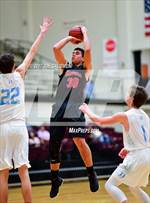 This MaxPreps.com professional photo features Stevens high school Jonathan Salazar playing  Basketball. This photo was shot by Joe Calomeni and published on Calomeni.