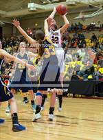 This MaxPreps.com professional photo features Colorado Springs Christian high school Megan Engesser playing Girls Basketball. This photo was shot by Jeffery Tucker and published on Tucker.