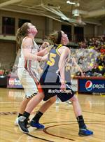 This MaxPreps.com professional photo features Colorado Springs Christian high school Katie McGrath playing Girls Basketball. This photo was shot by Jeffery Tucker and published on Tucker.