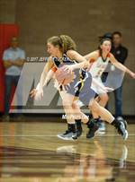 This MaxPreps.com professional photo features Colorado Springs Christian high school Rachel Ingram playing Girls Basketball. This photo was shot by Jeffery Tucker and published on Tucker.