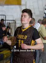 This MaxPreps.com professional photo features Cibola high school Zach Baca playing  Basketball. This photo was shot by Jesse Bartlett and published on Bartlett.