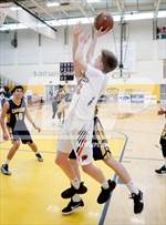 This MaxPreps.com professional photo features Pacifica Christian/Orange County high school Cal Whitney playing  Basketball. This photo was shot by Daryl Chan and published on Chan.