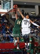 This MaxPreps.com professional photo is from the gallery Wheeler vs. Desoto (Thanksgiving Hoofest)  which features DeSoto high school athletes playing  Basketball.