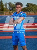 This MaxPreps.com professional photo features Folsom high school Daniyel Ngata playing  Football. This photo was shot by Todd Shurtleff and published on Shurtleff.
