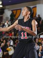 This MaxPreps.com professional photo is from the gallery Etiwanda @ Valencia (CIF SS Playoffs) which features Etiwanda high school athletes playing  Basketball.