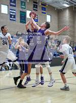 This MaxPreps.com professional photo is from the gallery Arvada West @ Dakota Ridge which features Arvada West high school athletes playing  Basketball. This photo was shot by Clemy Dalfonso and published on Dalfonso.