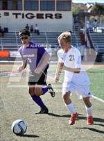 This MaxPreps.com professional photo is from the gallery Kirtland @ Aztec which features Kirtland Central high school athletes playing  Soccer. This photo was shot by Julie Carlson and published on Carlson.