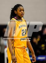 This MaxPreps.com professional photo features Riverdale Baptist high school Rochelle Norris playing Girls Basketball. This photo was shot by Darin Sicurello and published on Sicurello.