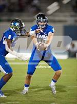 This MaxPreps.com professional photo features IMG Academy high school Trey Sanders and Zack Annexstad playing  Football. This photo was shot by Mike Janes and published on Janes.