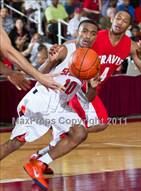 This MaxPreps.com professional photo is from the gallery Seven Lakes vs Fort Bend Travis (UIL 5A Regional Semi-Final) which features Seven Lakes high school athletes playing  Basketball.