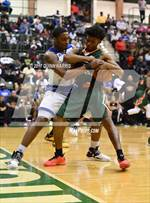 This MaxPreps.com professional photo features Morgan Park high school Cam Irvin playing  Basketball. This photo was shot by Quinn Harris and published on Harris.