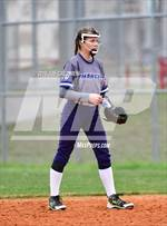 This MaxPreps.com professional photo features John F. Kennedy high school  playing  Softball. This photo was shot by Joe Calomeni and published on Calomeni.
