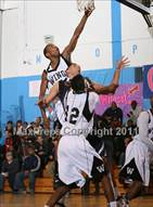 This MaxPreps.com professional photo is from the gallery Wings Academy vs Forest Hills (Queens Jam Christmas Classic) which features Wings Academy high school athletes playing  Basketball.