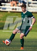 This MaxPreps.com professional photo features Ravenscroft high school Emmanuel Petrov playing  Soccer. This photo was shot by Alik McIntosh and published on McIntosh.