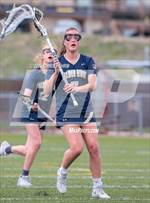 This MaxPreps.com professional photo features Palmer Ridge high school Holly Esposito playing Girls Lacrosse. This photo was shot by Chris Fehrm and published on Fehrm.