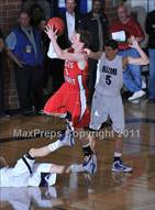 This MaxPreps.com professional photo is from the gallery Regis Jesuit @ Highlands Ranch which features Regis Jesuit high school athletes playing  Basketball.