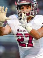 This MaxPreps.com professional photo is from the gallery Magnolia vs Magnolia West which features Magnolia high school athletes playing  Football.