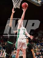 This MaxPreps.com professional photo is from the gallery ThunderRidge vs. Doherty (CHSAA 5A Great 8) which features ThunderRidge high school athletes playing  Basketball.