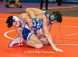 This MaxPreps.com professional photo is from the gallery NYSPHSAA Wrestling Championships (Division 1 First Round) which features Plainedge high school athletes playing  Wrestling. This photo was shot by Ray Passaro and published on Passaro.