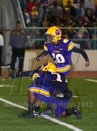 This MaxPreps.com professional photo is from the gallery Karr vs. St. Augustine (LHSAA Quarterfinal Playoff) which features Edna Karr high school athletes playing  Football.