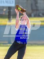 This MaxPreps.com professional photo features Falls City high school Kori Moore playing  Softball. This photo was shot by Lester Rosebrock and published on Rosebrock.