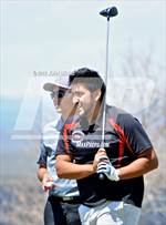 This MaxPreps.com professional photo is from the gallery Taos Invitational which features Robertson high school athletes playing  Golf. This photo was shot by John Denne and published on Denne.