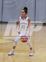This MaxPreps.com professional photo features MacArthur high school Sophia Schexnayder playing Girls Basketball. This photo was shot by Joe Calomeni and published on Calomeni.