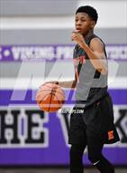 This MaxPreps.com professional photo is from the gallery Evanston @ Niles North which features Evanston high school athletes playing  Basketball.