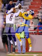 This MaxPreps.com professional photo is from the gallery Omaha North vs. Bellevue West (NSAA 1A Final)  which features Omaha North high school athletes playing  Football.
