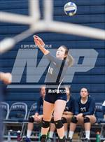 This MaxPreps.com professional photo features Vista del Lago high school Amber Olson playing  Volleyball. This photo was shot by Robert Schlie and published on Schlie.