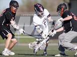 This MaxPreps.com professional photo features Lewis-Palmer high school Ryan Eells, Paxton Crowell playing  Lacrosse. This photo was shot by Kevin Prickett and published on Prickett.