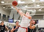 This MaxPreps.com professional photo features Madison high school Justin Weiszhaar playing  Basketball. This photo was shot by Kevin Hansen and published on Hansen.