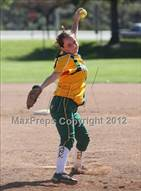 This MaxPreps.com professional photo is from the gallery Moorpark @ Simi Valley which features Moorpark high school athletes playing  Softball.