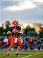 This MaxPreps.com professional photo is from the gallery Pontiac @ Rochester which features Rochester high school athletes playing  Football.