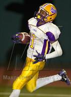 This MaxPreps.com professional photo is from the gallery Los Alamitos vs. Lynwood which features Lynwood high school athletes playing  Football.