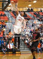 This MaxPreps.com professional photo features Granite City high school  playing  Basketball. This photo was shot by Jimmy Simmons and published on Simmons.