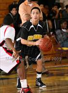 This MaxPreps.com professional photo is from the gallery Centennial vs. San Fernando (Lynwood Christmas Challenge) which features San Fernando high school athletes playing  Basketball.