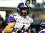 This MaxPreps.com professional photo features Rolling Meadows high school Andrew Neville playing  Football. This photo was shot by Dwane Lindsey and published on Lindsey.