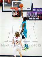 This MaxPreps.com professional photo is from the gallery North Valleys vs Whitney (Whitney Christmas Classic) which features North Valleys high school athletes playing  Basketball.