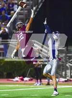 This MaxPreps.com professional photo features Magnolia high school Cameron Nava playing  Football. This photo was shot by Ken Murray and published on Murray.