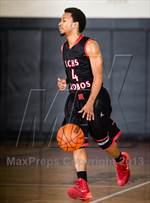 This MaxPreps.com professional photo features Langham Creek high school Dvon England playing  Basketball. This photo was shot by John Godwin and published on Godwin.