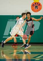 This MaxPreps.com professional photo features Woodgrove high school Owen Fuller playing  Basketball. This photo was shot by Clarence Thomas and published on Thomas.