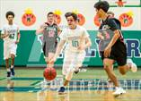 This MaxPreps.com professional photo features Woodgrove high school Tyler Blizzard playing  Basketball. This photo was shot by Clarence Thomas and published on Thomas.